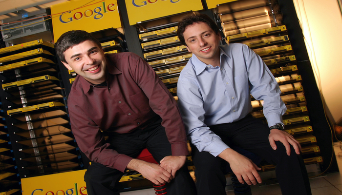 April 08, 2003: Larry Page (L), Co-Founder and President, Products and Sergey Brin, Co-Founder and President, Technology pose inside the server room at Google's campus headquarters in Mountain View. They founded the company in 1998. (Photo by Kim Kulish/Corbis via Getty Images)